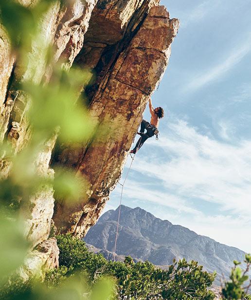 A climber climbs a mountain.