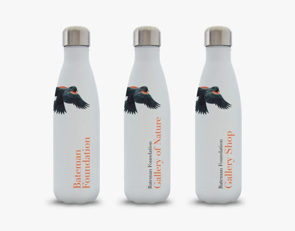 Three Bateman Foundation-branded water bottles.