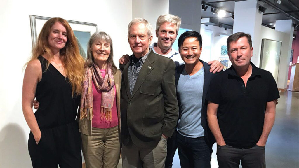 Five smiling people pose for a photograph in the Bateman Foundation's Gallery of Nature.