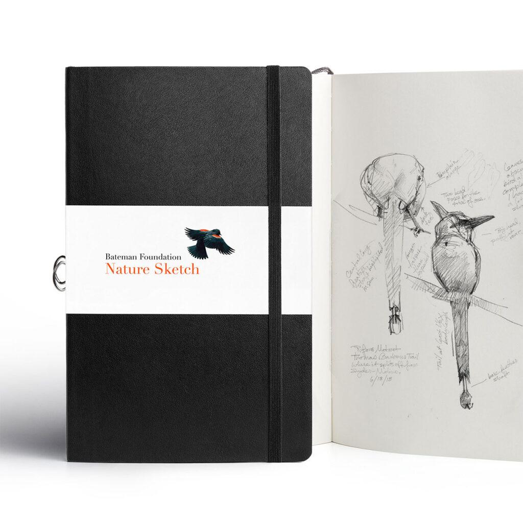 A Bateman Foundation-branded notebook.