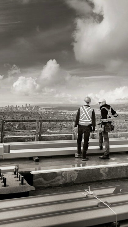 A photo of two people surveying the city from on high.