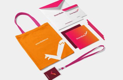 SmartBallot branded merchandise (a tote bag, folders, pencils, a lanyard)