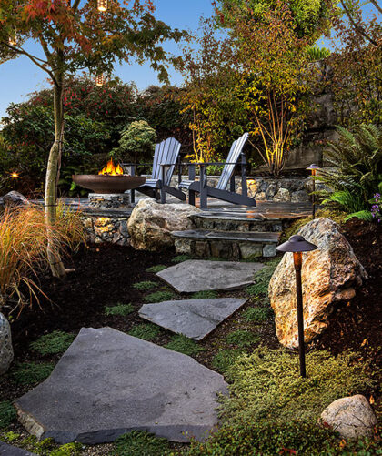 A photo of a landscaped patio and garden